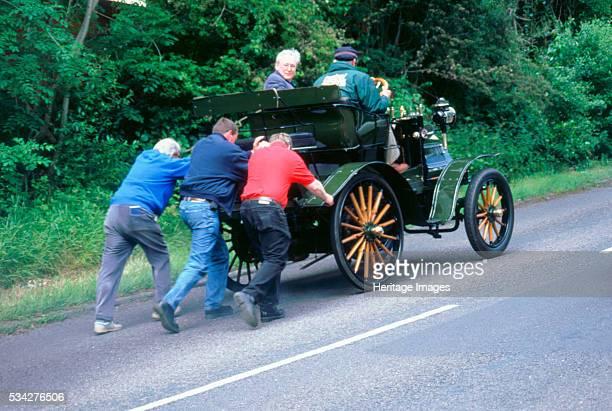 Daimler receving a push having broken down on a rally 2000