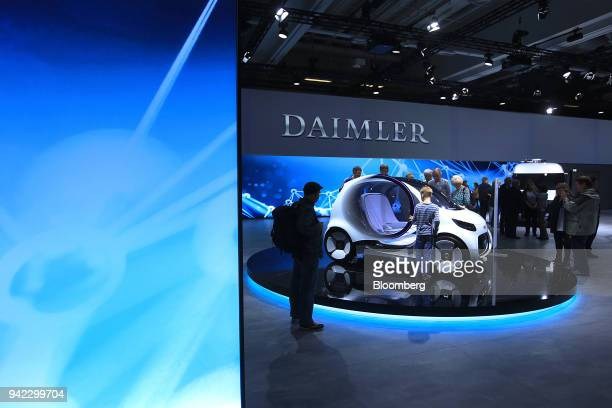 A Daimler Smart Vision EQ fortwo electric autonomous selfdriving compact concept automobile sits on during the Daimler AG shareholder meeting in...