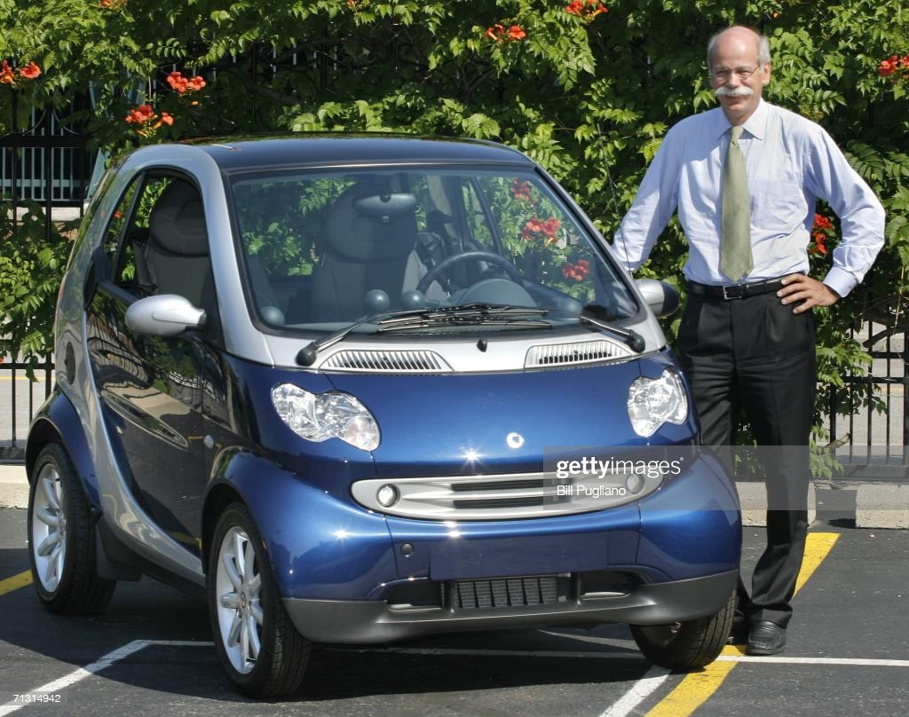 Daimlerchrysler Ag Chairman Ter Zetsche Poses For A Picture With The New Two Seat Smart