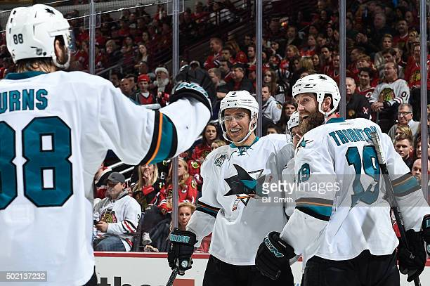 Dainius Zubrus and Joe Thornton of the San Jose Sharks celebrate with teammates after Joe Pavelski scored against the Chicago Blackhawks in the...