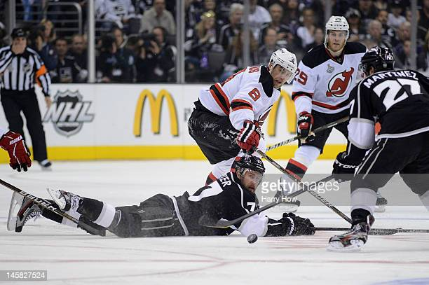Dainius Zubrus of the New Jersey Devils and Jeff Carter of the Los Angeles Kings watch the puck during Game Four of the 2012 Stanley Cup Final at...