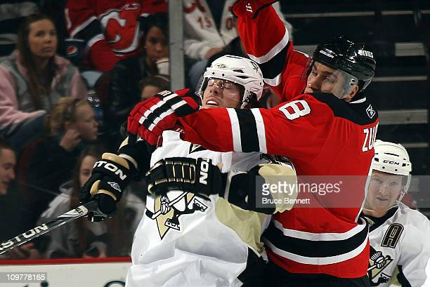 Dainius Zubrus of the New Jersey Devils hangs onto James Neal of the Pittsburgh Penguins at the Prudential Center on March 4 2011 in Newark New Jersey