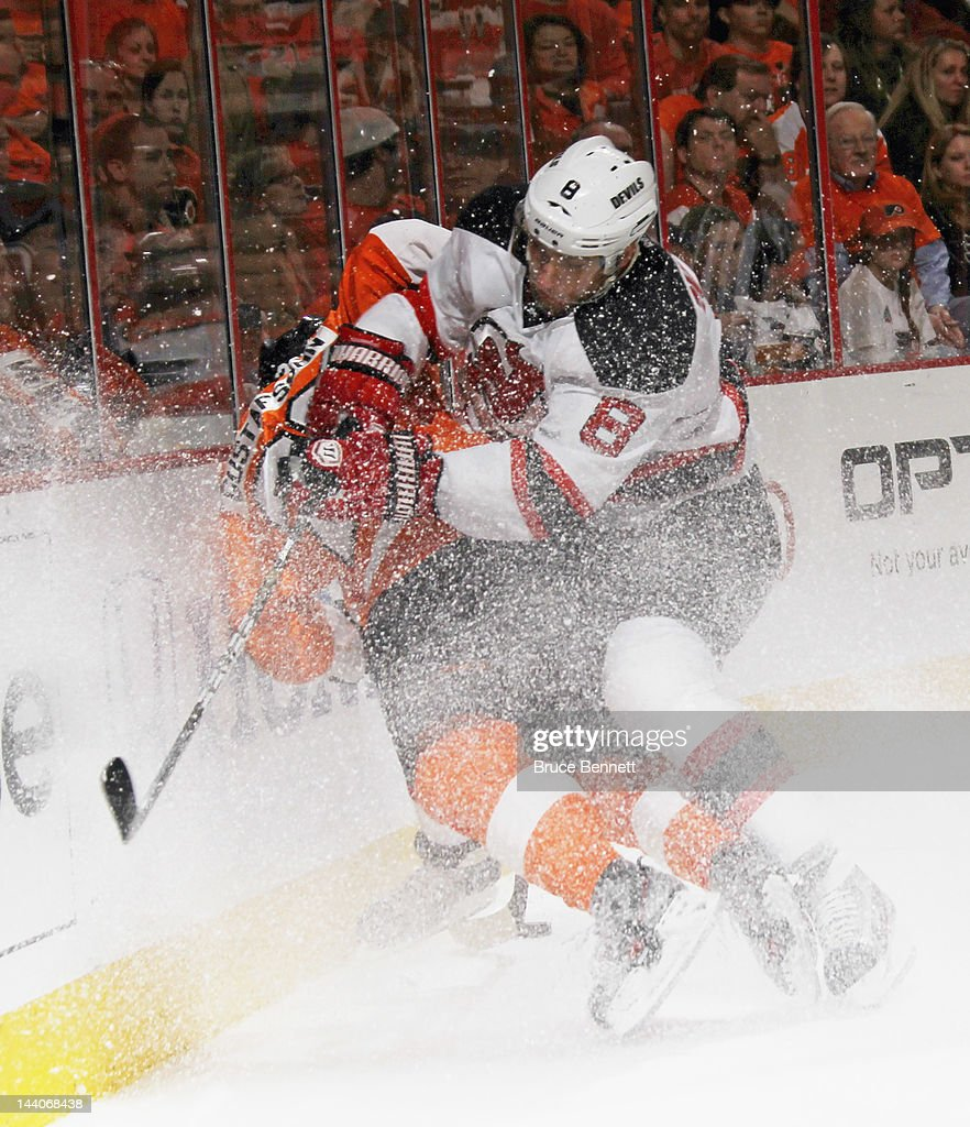 Dainius Zubrus #8 of the New Jersey Devils hits Erik Gustafsson #26 of the Philadelphia Flyers in Game Five of the Eastern Conference Semifinals during the 2012 NHL Stanley Cup Playoffs at Wells Fargo Center on May 8, 2012 in Philadelphia, Pennsylvania. The Devils defeated the Flyers 3-1 to win the series four games to one and move on to the Conference Finals.