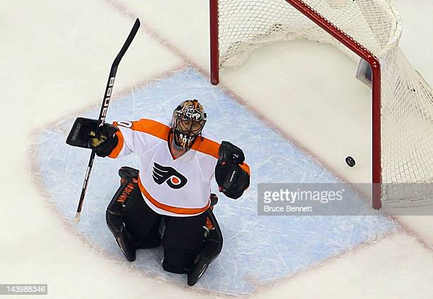 Dainius Zubrus of the New Jersey Devils scores against Ilya Bryzgalov of the Philadelphia Flyers at 1747 of the second period in Game Four of the...
