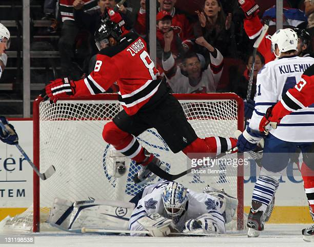 Dainius Zubrus of the New Jersey Devils scores on the power play at 1216 of the first period against Jonas Gustavsson the Toronto Maple Leafs at the...