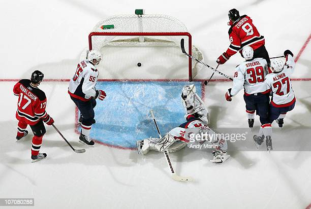 Dainius Zubrus of the New Jersey Devils skates around the net after scoriong a goal against goaltender Braden Holtby of the Washington Capitals...