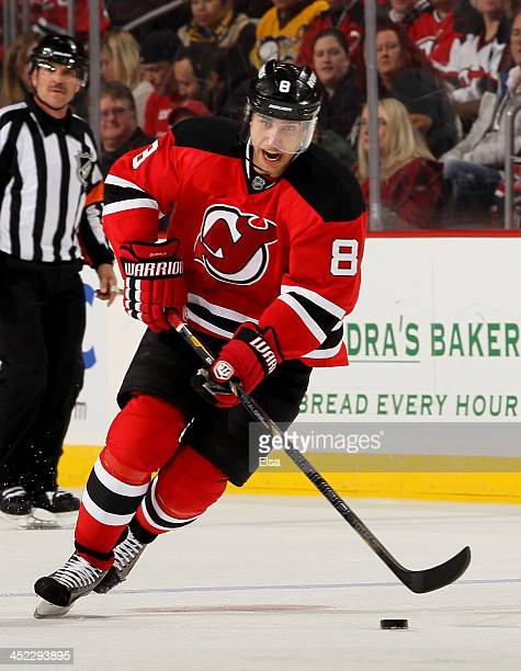 Dainius Zubrus of the New Jersey Devils takes the puck against the Pittsburgh Penguins at Prudential Center on November 16 2013 in Newark New Jersey