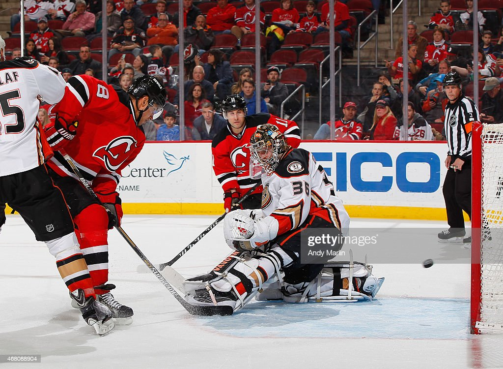 Dainius Zubrus #8 of the New Jersey Devils tips the puck past John Gibson #36 of the Anaheim Ducks for a third period goal during the game at the Prudential Center on March 29, 2015 in Newark, New Jersey.