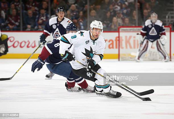 Dainius Zubrus of the San Jose Sharks skates infront of Jack Skille of the Colorado Avalanche at the Pepsi Center on February 24 2016 in Denver...