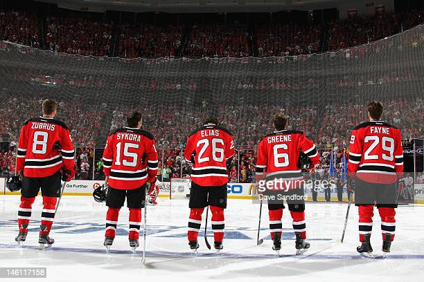 Dainius Zubrus Petr Sykora Patrik Elias Andy Greene and Mark Fayne of the New Jersey Devils line up on the ice before playing the Los Angeles Kings...