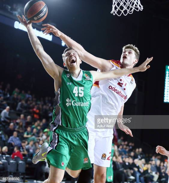 Dairis Bertans #45 of Darussafaka Dogus Istanbul competes with Tibor Pleiss #21 of Galatasaray Odeabank Istanbul during the 2016/2017 Turkish...