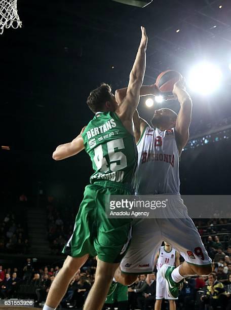 Dairis Bertans of Darussafaka Dogus in action against Adam Hanga of Baskonia Vitoria during Turkish Airlines Euroleague basketball match between...