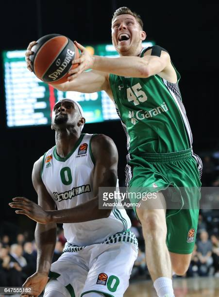 Dairis Bertans of Darussafaka Dogus in action against Chris Singleton of Panathinaikos Superfoods during the Turkish Airlines Euroleague basketball...
