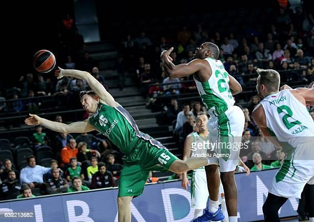 Dairis Bertans of Darussafaka Dogus in action against Latavious Williams of UNICS Kazan during Turkish Airlines Euroleague basketball match between...