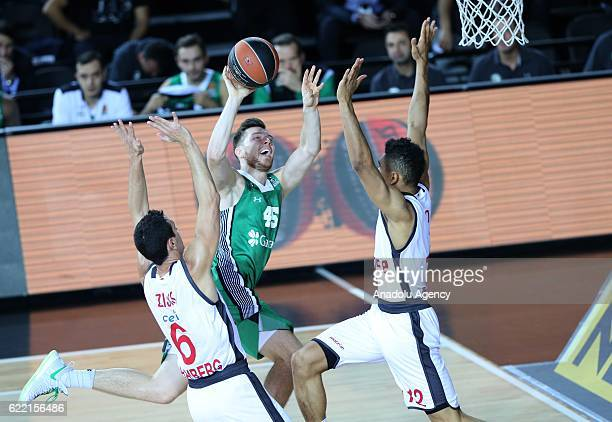 Dairis Bertans of Darussafaka Dogus in action against Maodo Lo and Nikos Zisis of Brose Bamberg during the Turkish Airlines Euroleague basketball...