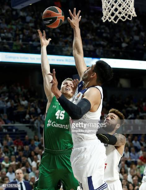 Dairis Bertans of Darussafaka Dogus vies with Gustavo Ayon of Real Madrid during the Turkish Airlines EuroLeague Playoffs quarterfinal 2nd leg match...