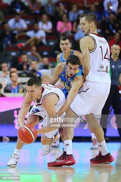 Dairis Bertans of Latvia competes with Pavlo Krutous of Ukraine during the FIBA EuroBasket 2015 Group D basketball match between Latvia and Ukraine...
