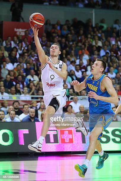 Dairis Bertans of Latvia shoots for the basket during the FIBA EuroBasket 2015 Group D basketball match between Latvia and Ukraine at Arena Riga on...