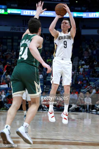 Dairis Bertans of the New Orleans Pelicans shoots over Pat Connaughton of the Milwaukee Bucks during the second half of a NBA game at the Smoothie...