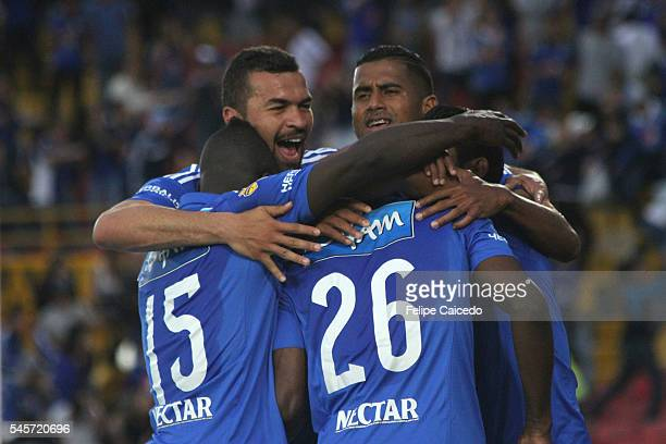 Dairon Asprilla of Millonarios celebrates with teammates after scoring the first goal of his team during a match between Millonarios and Santa Fe as...