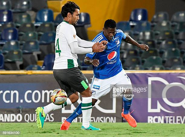 Dairon Asprilla of Millonarios struggles for the ball with Abel Aguilar of Cali during a match between Millonarios and Deportivo Cali as part of...