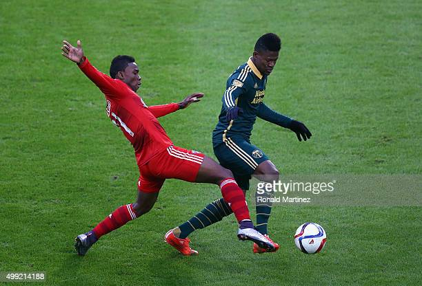 Dairon Asprilla of Portland Timbers dribbles the ball past Fabian Castillo of FC Dallas during the Western Conference FinalsLeg 2 of the MLS playoffs...