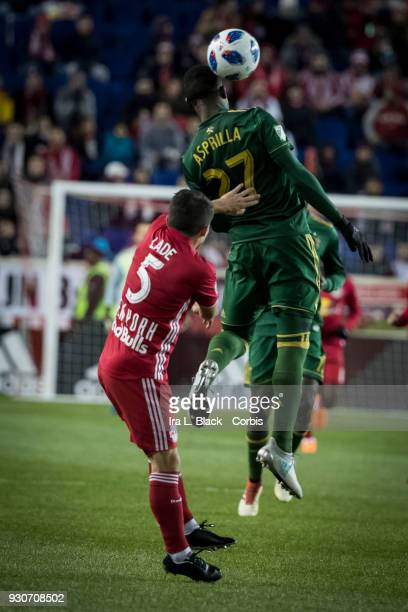 Dairon Asprilla of Portland Timbers goes up for the header with Connor Lade of New York Red Bulls right behind him during the MLS match between New...