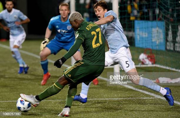 Dairon Asprilla of Portland Timbers tries to get aroun Matt Besler of Sporting Kansas City during the first half of the match at Providence Park on...