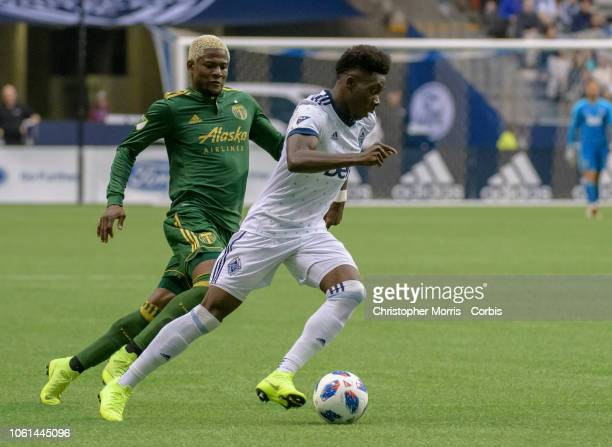 Dairon Asprilla of the Portland Timbers chases Alphonso Davies of the Vancouver Whitecaps at BC Place on October 28 2018 in Vancouver Canada