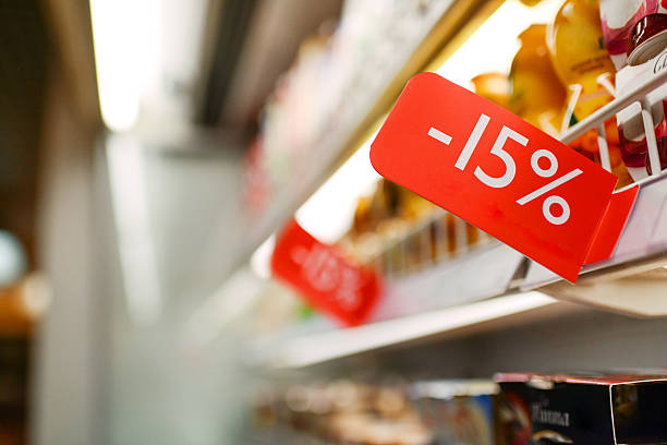 dairy discount in grocery store - sale stock pictures, royalty-free photos & images