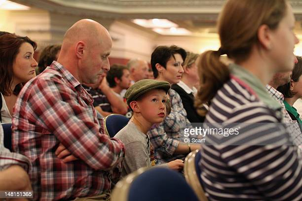 Dairy farmers from across the UK attend a rally in the Methodist Central Hall to protest against proposed cuts to the price dairy processors pay for...