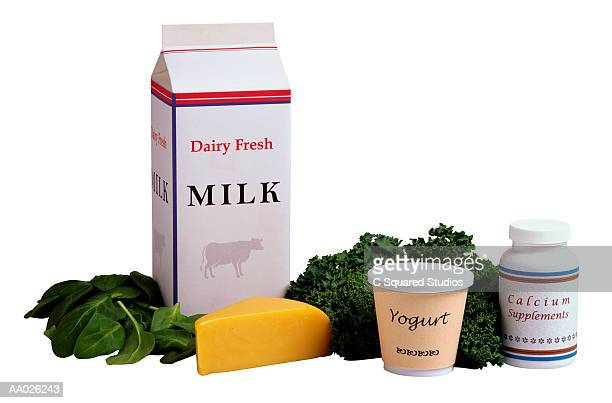 dairy products and greens rich in calcium - milk carton stock photos and pictures