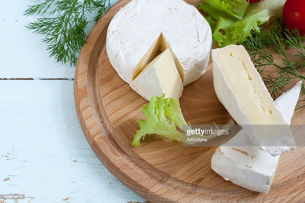 Dairy products. Camembert and brie cheese. : Stock Photo