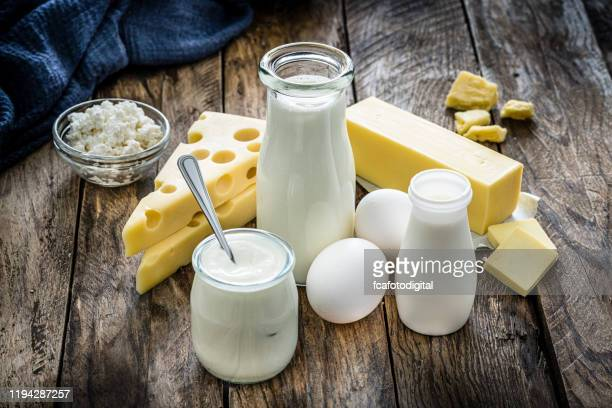 dairy products on rustic wooden table - cheese stock pictures, royalty-free photos & images
