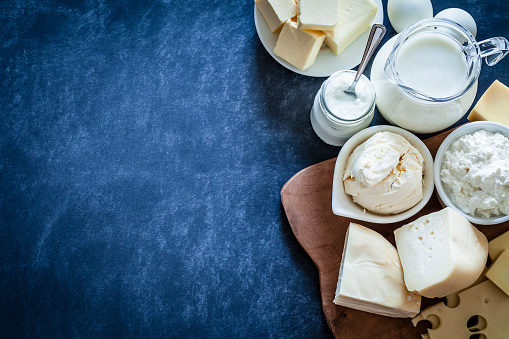 Dairy products shot on bluish tint background 909574006
