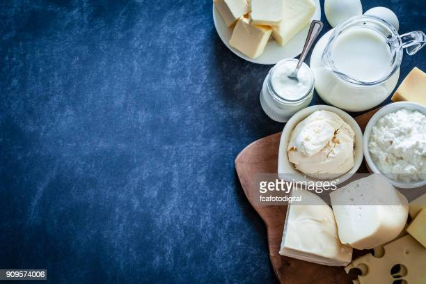 dairy products shot on bluish tint background - cheese stock pictures, royalty-free photos & images