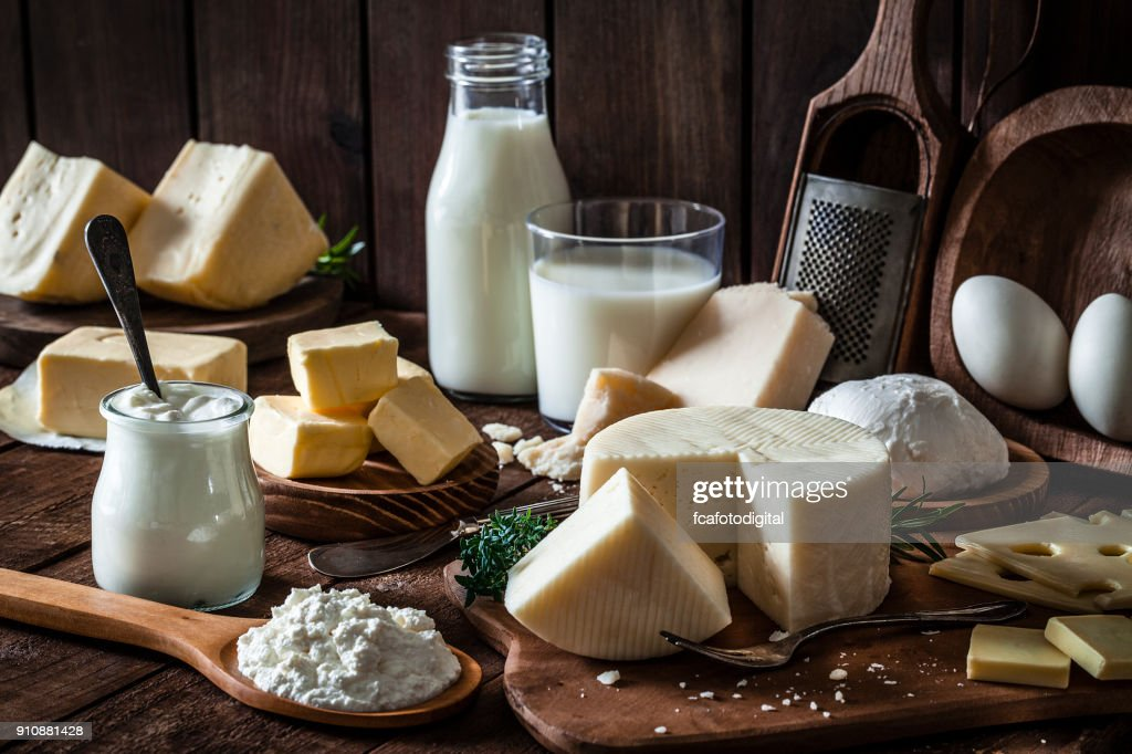 Dairy products shot on rustic wooden table : Stock Photo