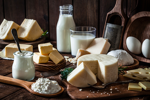 Dairy products shot on rustic wooden table 910881428