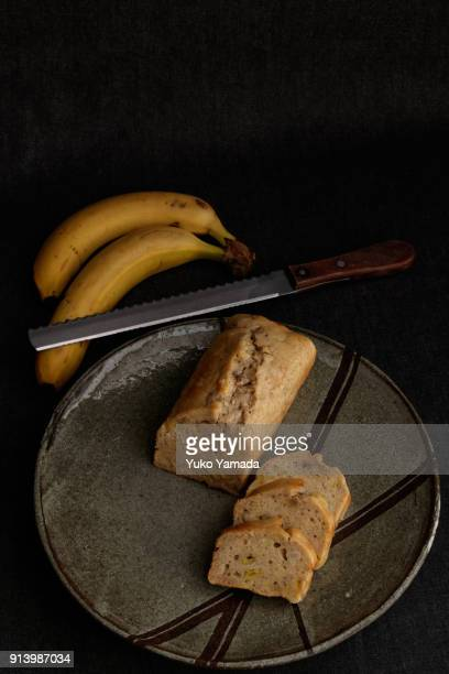Dairy-free Banana Bread Slices on a Rustic Pottery Plate with Dark Background