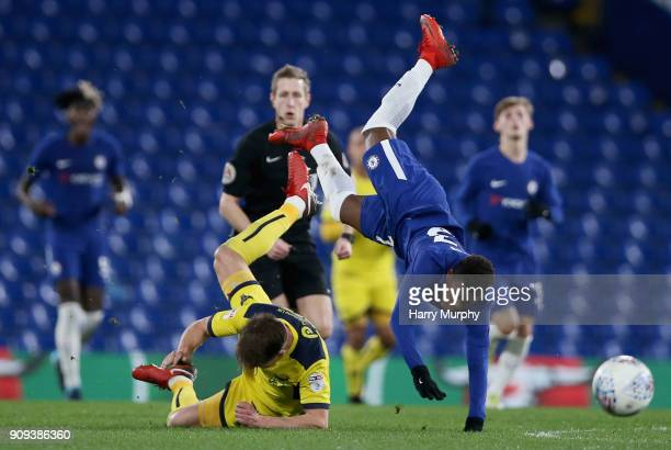 Daishawn Redan of Chelsea and Charlie Raglan of Oxford United collide during the Checkatrade Trophy match between Chelsea U21 and Oxford United at...