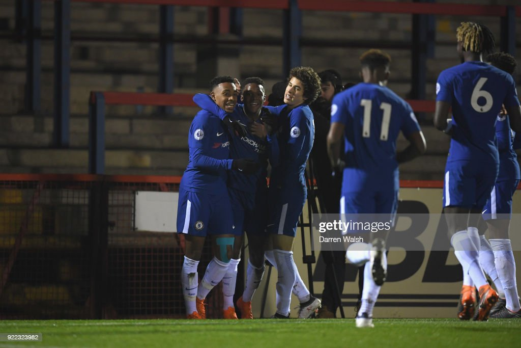Daishawn Redan of Chelsea celebrates his goal and Chelsea's 2nd with Juan Castillo and Harvey St Clair during the UEFA Youth League Round of 16 match between Chelsea FC and Feyenoord at EBB Stadium on February 21, 2018 in Aldershot, United Kingdom.