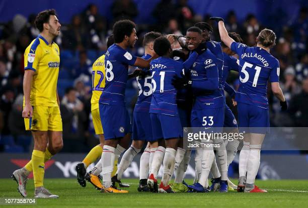 Daishawn Redan of Chelsea celebrates with teammates after scoring his team's second goal during the Checkatrade Trophy second round match between...