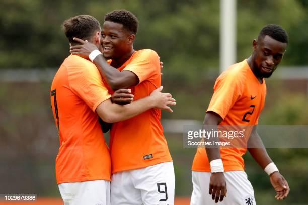 Daishawn Redan of Holland U19 celebrates 40 with Orkun Kokcu of Holland U19 Lutsharel Geertruida of Holland U19 during the match between Holland U19...