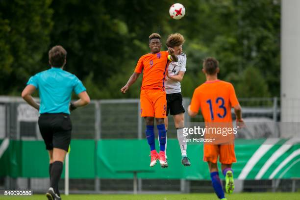 Daishawn Redan of the Netherlands and Niclas Knoop of Germany battle for the ball during the 'Four Nation' match between U17 Germany and U17...