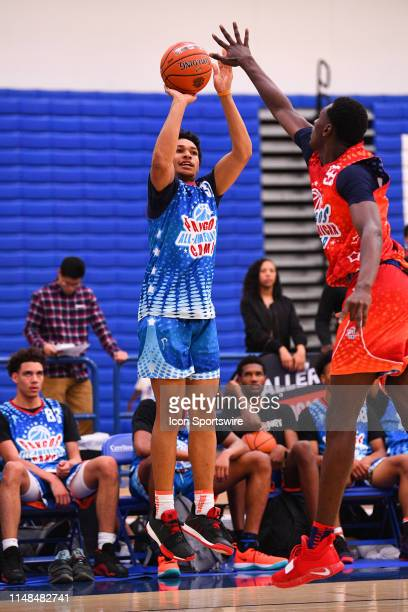 Daishen Nix from Trinity High School shoots over a defender the Pangos AllAmerican Camp on June 2 2019 at Cerritos College in Norwalk CA