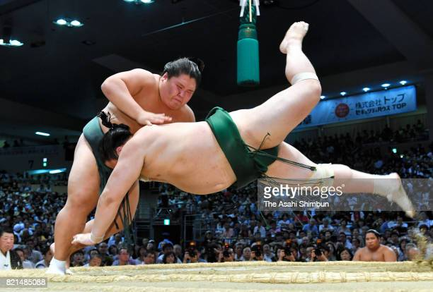 Daishomaru throws Sadanoumi to win during day fourteen of the Grand Sumo Nagoya Torunament at Aichi Prefecture Gymnasium on July 22 2017 in Nagoya...