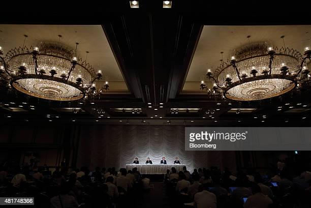 Daisuke Arakawa chief manager of Nikkei Inc left to right Naotoshi Okada president and chief executive officer Tsuneo Kita chairman and Hirotomo...
