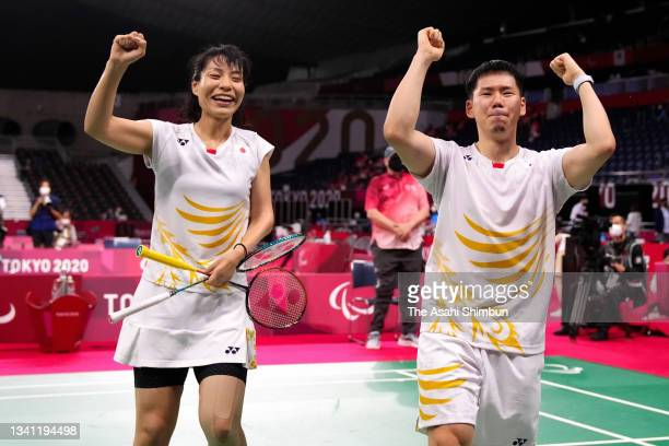 Daisuke Fujihara and Akiko Sugino of Team celebrate winning the bronze medal after their victory the Badminton Mixed Doubles SL3-SU5 Bronze Medal...