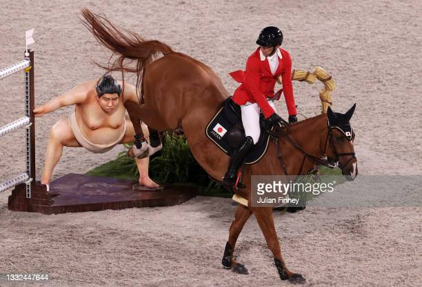 Daisuke Fukushima of Team Japan riding Chanyon clears the sumo wrestler jump during the Jumping Individual Final on day twelve of the Tokyo 2020...
