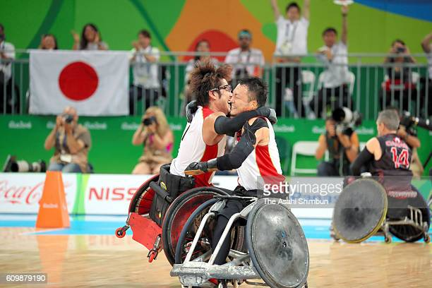 Daisuke Ikezaki and Yukinobu Ike of Japan celeberate winning the bronze medals after the Wheelchair Rugby bronze medal match between Japan and Canada...